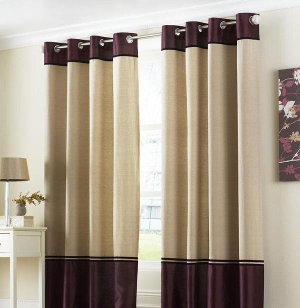 Дизайн штор тоже может дополняться оригинальными кольцами, декорированными под кожу, натуральное дерево или другие материалы