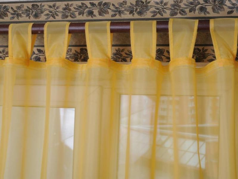 Занавески на петлях - это классический вариант, который просто и легко шить