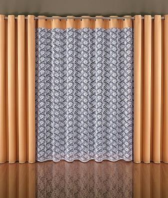Чтобы комнаты в вашем жилище казалось больше и просторнее, повесьте на окна шторы тюль на люверсах