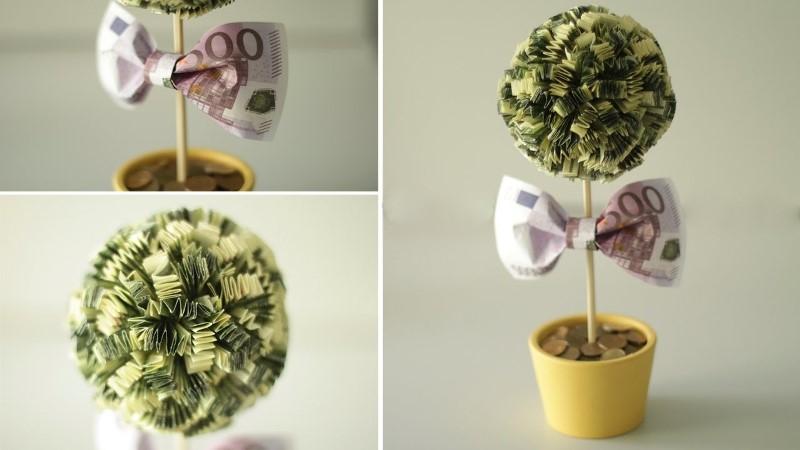 Топиарий (денежное дерево) эффектно смотрится при использовании крупных купюр, особенно долларов или евро